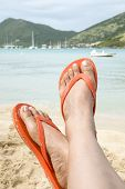 Woman Wearing Orange Flip Flop on the Beach