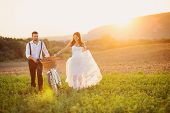 stock photo of wifes  - Beautiful bride and groom wedding portrait with white bike - JPG