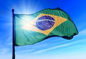 picture of apex  - Brazil flag waving on the wind on blue sky - JPG
