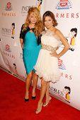 Paulina Rubio and Eva Longoria Parker at the 9th Annual Padres Contra El Cancer's 'El Sueno de Esperanza'. Hollywood Palladium, Hollywood, CA. 09-10-09