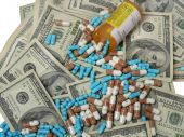 picture of lobbyist  - Photo of prescription drugs and pile of money - JPG