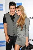 Cody Longo and Cassie Scerbo at the Macy`s Passport 2009 Fashion Show, Barker Hanger, Santa Monica,
