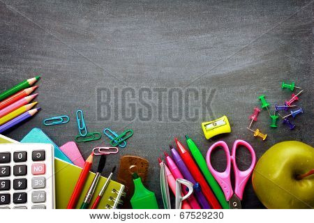 School Supplies On Blackboard Background poster