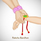 Beautiful background for Raksha Bandhan celebrations with girl tying rakhi on brother hand on grey b