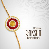 Rakhi on floral decorated grey background on the occasion of Happy Raksha Bandhan.