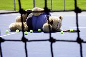 Tennis Player Through Net