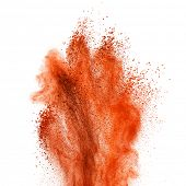 Red powder explosion isolated on white background