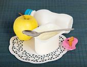 Dairy food, apple, soother and napkin