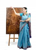 Artist In Indian Sari Posing With Pyrography Painting Lotus