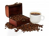 Chest with grains, a cup about the coffee