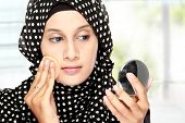 Woman With Cotton Pad Applying Face Powder
