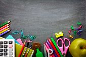 foto of calculator  - School supplies on blackboard background ready for your design - JPG