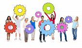 Diverse People Holding Colorful Cogs
