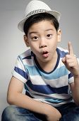 Portrait Of Little Asian Cute Boy With Whit Hat