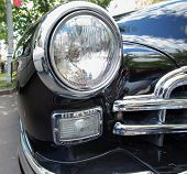 GAZ-12 ZIM car headlight on show of collection Retrofest cars