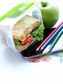 sandwich with cheese and tomato and green apple for a healthy school lunch