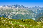 Hiking To Argentiere Glacier With The View On The Massif Des Aiguilles Rouges In French Alps