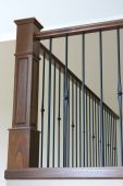 stock photo of bannister  - Bannister with wrought iron and beautiful stained oak - JPG