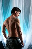 stock photo of envy  - a sexy hot man stands and waits - JPG