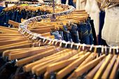 pic of no clothes  - Clothing and retail store: view of clothes shop with jeans hanged on stand [[** Note: Shallow depth of field] [[** Note: Soft Focus at 100%, best at smaller sizes] ** Note: Visible grain at 100%, best at smaller sizes - JPG