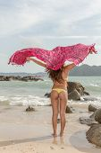Asian bikini model with sarong on the beach
