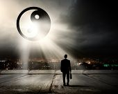 Rear view of businessman looking at yin yang sign