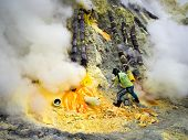 Sulfur Miner At Work Inside Crater Of Kawah Ijen, Indonesia