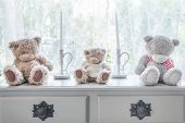 Many Bear Doll And Candle On Table And Windowsill Background