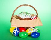 Easter cake in a basket and colourful eggs