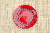 Empty Red Ceramic Plate On Table