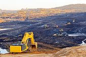 picture of open-pit mine  - open coal mining pit with heavy machinery - JPG