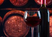Wine Glass Near Bottle In Old Wine Cellar Background