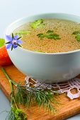 foto of borage  - Vegetables Bouillon Decorated with Parsley and Borage flower - JPG