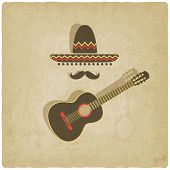 Mexican sombrero and guitar old background