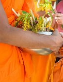 Monks Receiving Flower Offering