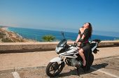 Girl, Motorcycle, Sea.
