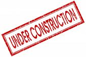 Under Construction Red Square Grungy Stamp Isolated On White Background