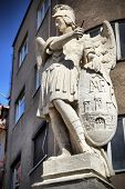 picture of archangel  - Ancient statue of archangel Michael with emblem of Bratislava city on the shield - JPG