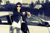Fashion punk woman standing at the car