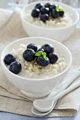 Rice pudding with syrup and berries