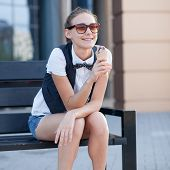 Sitting Happy Girl Eating Ice Cream