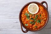 stock photo of vegetable soup  - vegetable soup with red lentils and tomatoes close - JPG