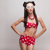 Pin Up Model In Heart Shaped Sunglasses. Red Polka Shorts And Bra