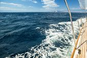 Boat in sailing regatta. Picture with space for text.