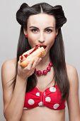 Closeup Of Biting Off A Hot Dog Pinup Smiling Model