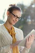 Closeup Of Young Smart Woman With Ipad Outdoors. Distance Education.