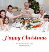Family drinking a toast in a Christmas dinner against happy christmas