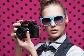 Closeup Of Trendy Girl Face In Colorful Sunglasses With Vintage Camera