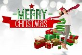 Happy brunette leaning and holding his scarf against merry christmas message with graphics