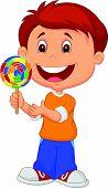 Little boy holding lollipop candy